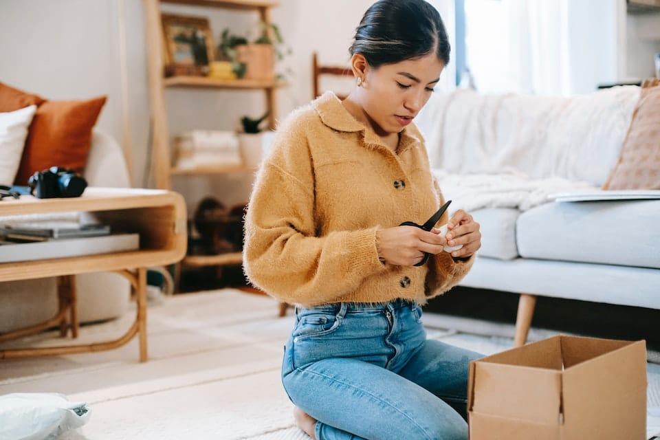 woman preparing to return clothing via mail