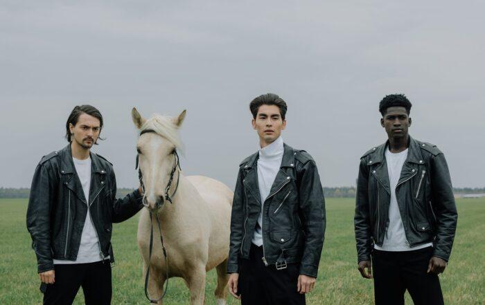 three men wearing leather jackets