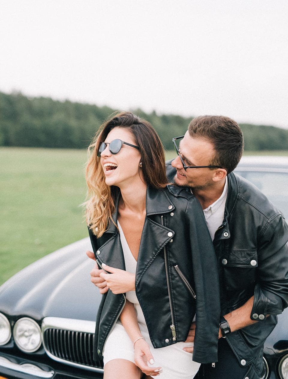 woman and man wearing leather jackets